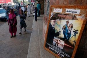 An advertising poster for a Pakistani film with Indian actors is seen outside a movie theatre in Karachi. Credit: Reuters