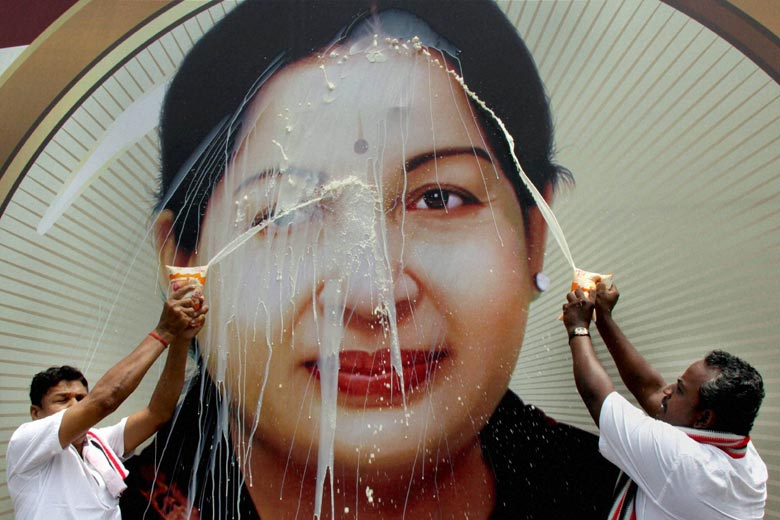 In Coimbatore, a group of party workers performed 'milk abhishekam' (pouring of milk) on a portrait of Jayalalithaa after she got acquitted in a court case in 2015. Credit: PTI