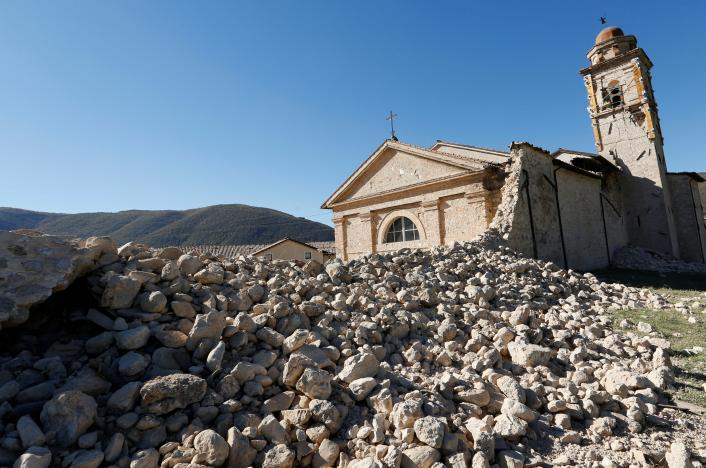 The church of the Madonna of the Angels is seen partially collapsed following an earthquake along the road to Norcia, Italy, October 30, 2016. REUTERS/Remo Casilli