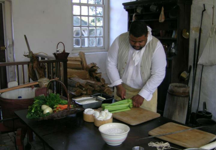 Michael Twitty cooking in a re-enactment costume. Credit: Facebook