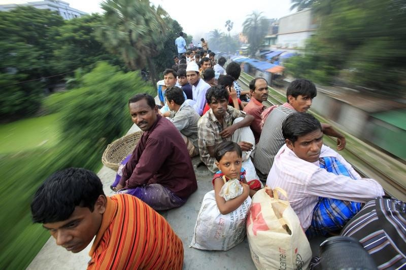 Passengers sit on top of an overcrowded train as it heads for Jamalpur from Dhaka August 16, 2012. Credit: Reuters/Andrew Biraj/Files