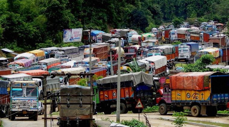 Vehicles stranded at NH 44 which got damaged due to incessant rains at Tripura and Assam border in Churaibari, North Tripura. Credit: PTI