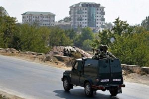 An army vehicle moves towards the multi-storied EDI building. Credit: PTI