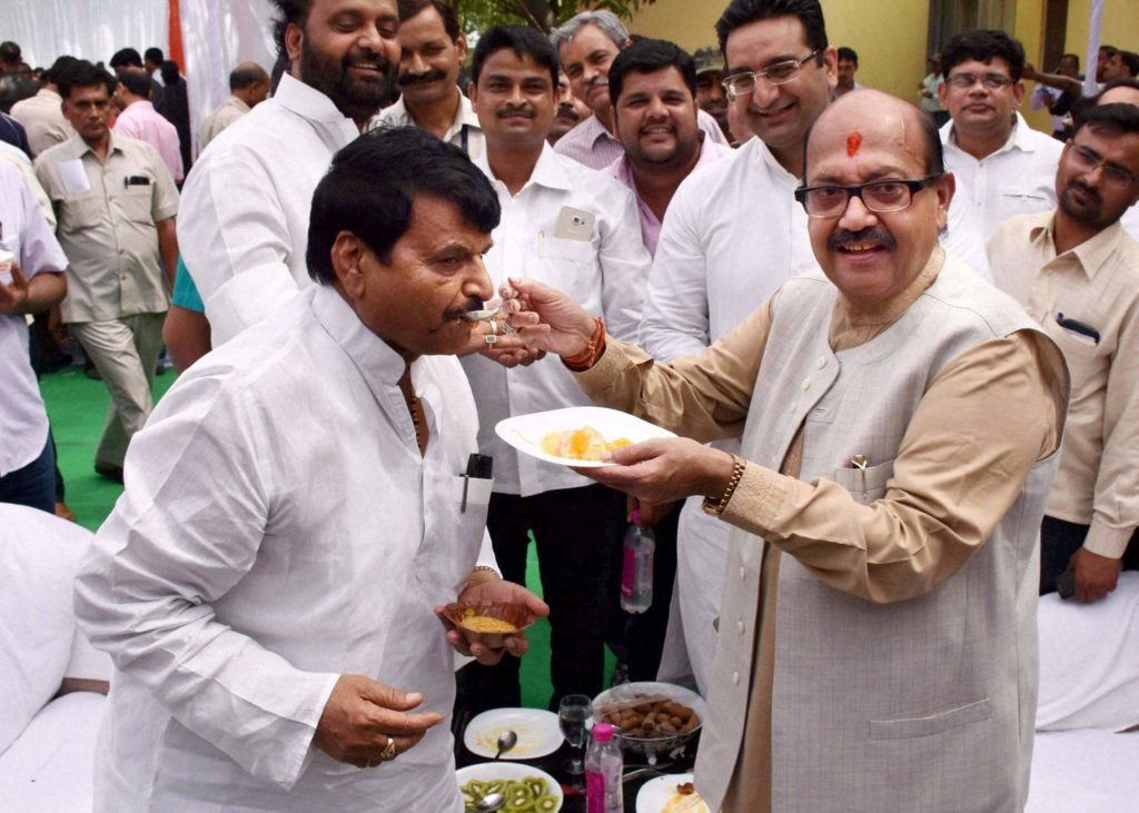 File photo of Samajwadi Party leaders Shivpal Yadav (left) with Amar Singh. Credit: PTI