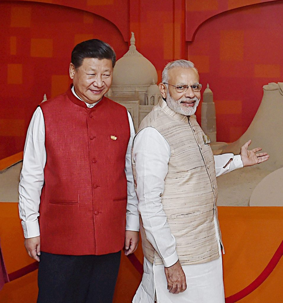 Prime Minister Narendra Modi and Chinese President Xi Jinping wearing khadi jackets in front of a sand sculpture made by Sudarsan Pattnaik in Benaulim, Goa on Saturday. Credit: PTI/Shahbaz Khan