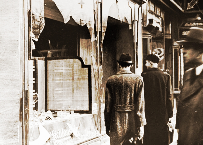An archival photo from November 10, 1938, showing broken shop windows in Berlin a day after the Nazi pogrom known as Kristallnacht concluded. Credit: notionscapital/Flickr, CC BY 2.0
