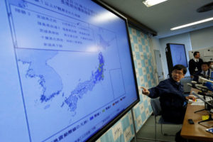 Japan Meteorological Agency's earthquake and volcano observations division director Koji Nakamura points at a map showing earthquake information during a news conference in Tokyo, Japan November 22, 2016. Credit: Reuters