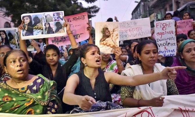 Women block the roads as they sit in protest against domestic violence in Kolkata on Wednesday. Credit: PTI/Ashok Bhaumik