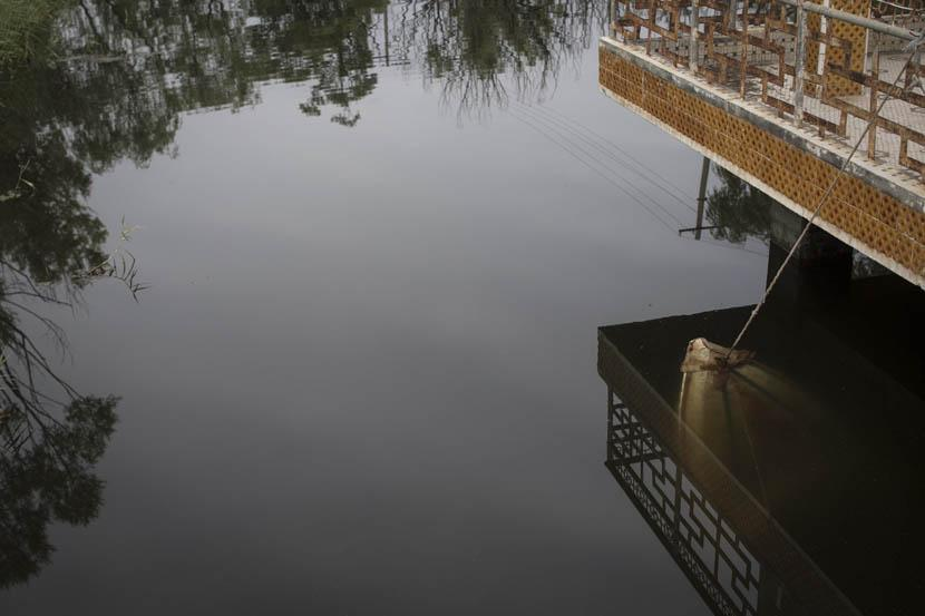 A tip of a sunken boat pokes out of the water in 404 City's Nuclear City Park. Credit: Xu Haifeng/Sixth Tone