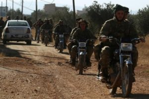 Rebel fighters drive their motorcycles, western Aleppo city, Syria November 3, 2016. Credit: Reuters/Ammar Abdullah