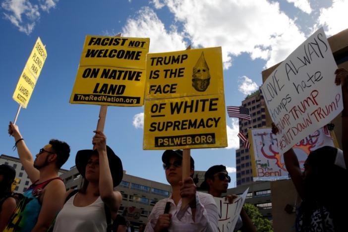 Protesters picket outside the event site before Republican U.S. presidential candidate Donald Trump begins a rally with supporters in Albuquerque, New Mexico, U.S. May 24, 2016. Credit: Jonathan Ernst/Reuters /Files
