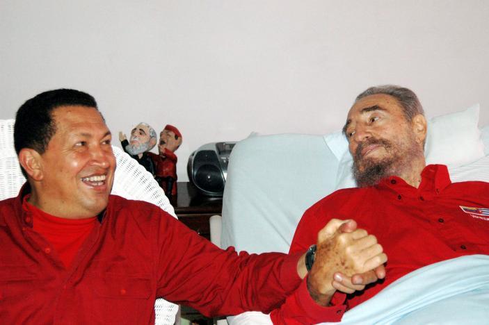 Venezuelan President Hugo Chavez (L) visits his then Cuban counterpart Fidel Castro in Havana in this August 13, 2006 file photo. Credit:Reuters/Estudios Revolucion-Granma/Handout/File Photo