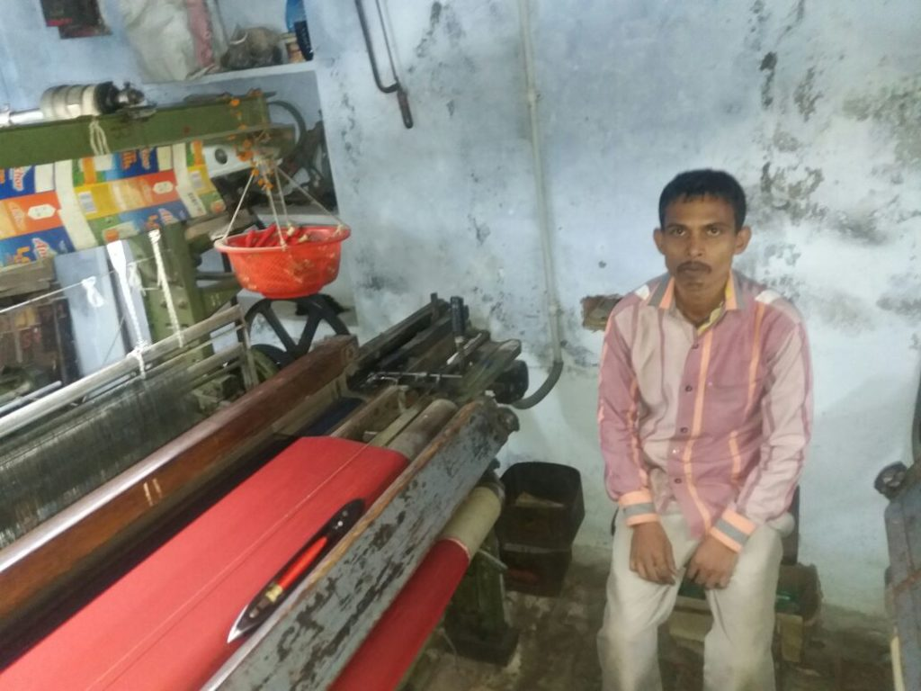 A weaver in Varanasi's Badi Bazaar area. He has shut down his loom due to a lack of cash. Credit: Shwetank Mishra