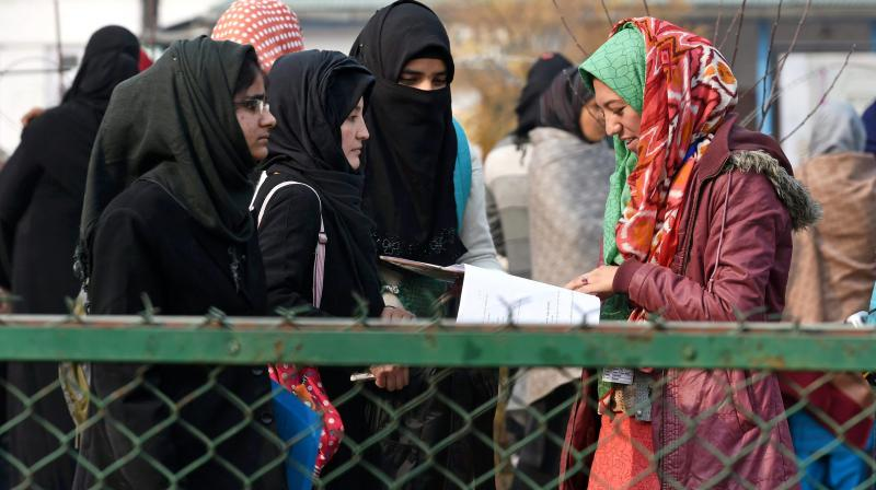 Students leaving an exam centre in Srinagar after giving an exam on Monday. Credit: PTI