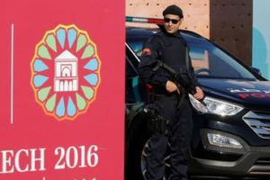 Moroccan security stand guard in front of the entrance of the World Climate Change Conference 2016 (COP22) in Marrakech, Morocco, November 9, 2016. Credit: Reuters/Youssef Boudlal