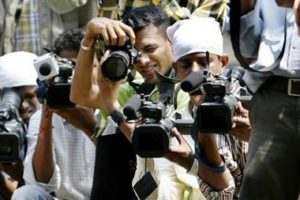File photo of photographers and video cameramen. Credit: Reuters