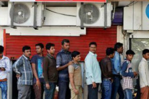 People queue outside an ATM of State Bank of India to withdraw cash in Ahmedabad, India, November 27, 2016. Credit: Reuters/Amit Dave