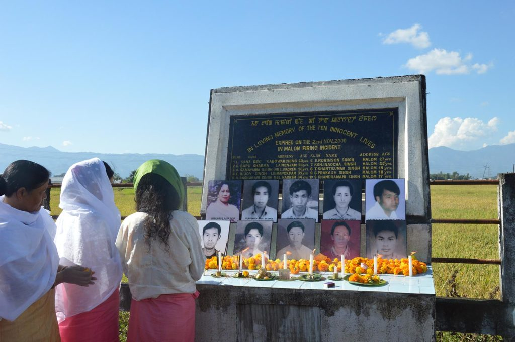 Irom Sharmila, in a green head-scarf, pays tribute at the 16th anniversary memorial of the Malom massacre, which prompted her nearly 16-year hunger strike. Credit: Grace Jajo