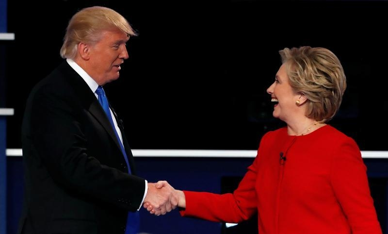Republican U.S. presidential nominee Donald Trump and Democratic U.S. presidential nominee Hillary Clinton shake hands at the end of their first presidential debate at Hofstra University in Hempstead, New York in September. Credit: Mike Segar, Reuters