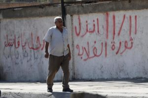 A man walks in front of a wall with graffiti asking Egyptians to participate in demonstrations against the Egyptian regime and against economic conditions following the rise of prices around the country, in Cairo, Egypt November 9, 2016.  REUTERS/Amr Abdallah Dalsh