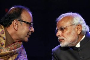 Prime Minister Narendra Modi listens to finance minister Arun Jaitley during the Global Business Summit in New Delhi January 16, 2015. Credit: Reuters/Anindito Mukherjee