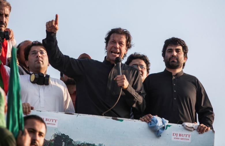 Imran Khan (C), the Chairman of the Pakistan Tehreek-e-Insaf (PTI) political party, addresses supporters during the Revolution March in Islamabad August 31, 2014. Credit: REUTERS/Faisal Mahmood/File Photo
