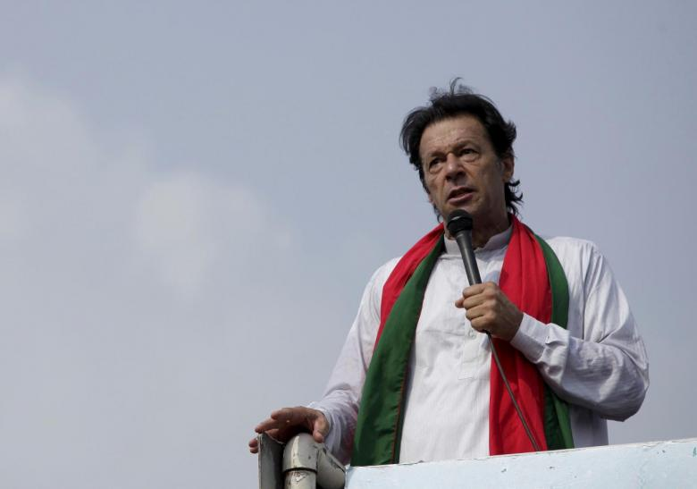 """Chairman of the Pakistan Tehreek-e-Insaf (PTI) political party Imran Khan addresses his supporters during what has been dubbed a """"freedom march"""" in Islamabad August 21, 2014. REUTERS/Faisal Mahmood/Files"""