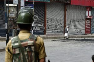 A CRPF personnel stands guard on strike day in Srinagar. Credit: PTI/Files