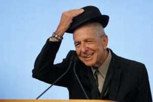 Musician Leonard Cohen tips his hat to the audience as he accepts the 2012 Awards for Song Lyrics of Literary Excellence at the John F. Kennedy Presidential Library and Museum, in Boston, Massachusetts, U.S. on February 26, 2012.   REUTERS/Jessica Rinaldi/File Photo
