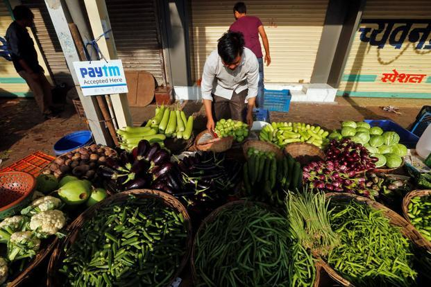 """There is immense pressure on India's rural citizens and denizens of the informal sector to tread the virtuous path to digital """"you pay, we play"""" pens like Paytm. Credit: Reuters"""