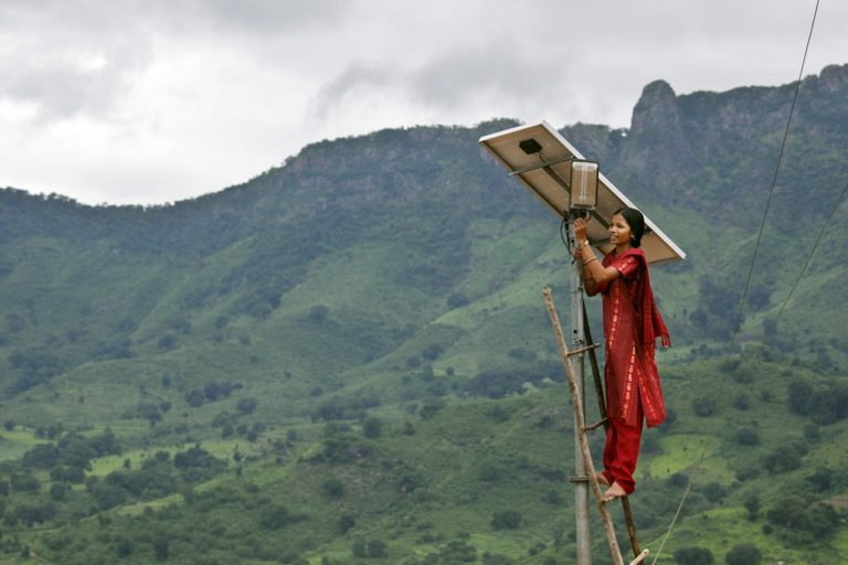 Meenakshi Dewan doing maintenance work on a solar street lighting in her village of Tinginaput, India Credit: Abbie Trayler-Smith, Department for International Development/The Third Pole