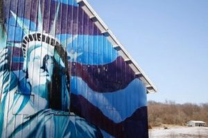 A barn is painted with an image of the Statue of Liberty. Credit: Reuters