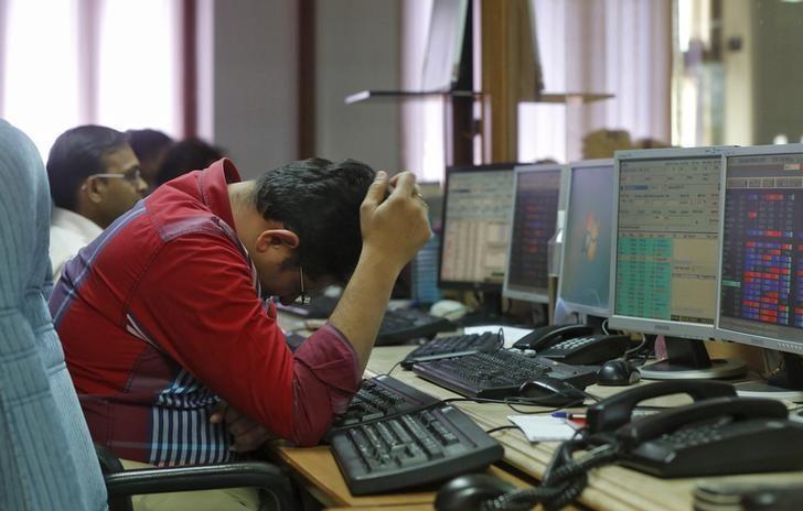 A broker reacts while trading at his computer terminal at a stock brokerage firm in Mumbai, India. Credit: Reuters/Shailesh Andrade/Files