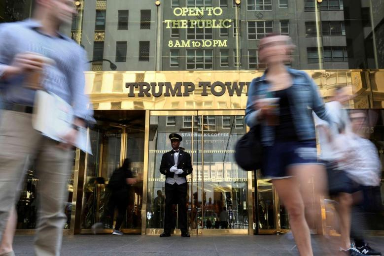 A doorman stands as people walk past the Trump Tower in New York, US, May 23, 2016. Credit: Reuters/Carlo Allegri/File Photo