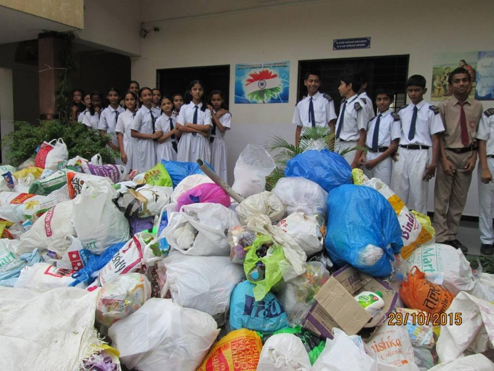 School students with plastic items they've helped collect under the Sagar-Mitra Abhiyaan programme. Credit: Scharada Dubey