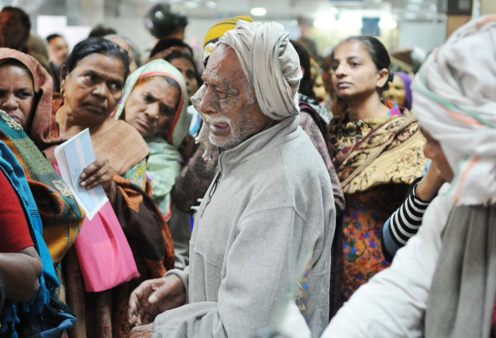 This photograph of an old man, an ex-serviceman, crying after missing his spot at a queue outside a State Bank of India branch in Gurgaon is the defining image of the demonetisation story. Credit: Parveen Kumar, Hindustan times
