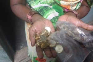 Rajvati Yadav leaving the bank with a packet of Rs 5 coins. Credit: Suryanshi Pandey