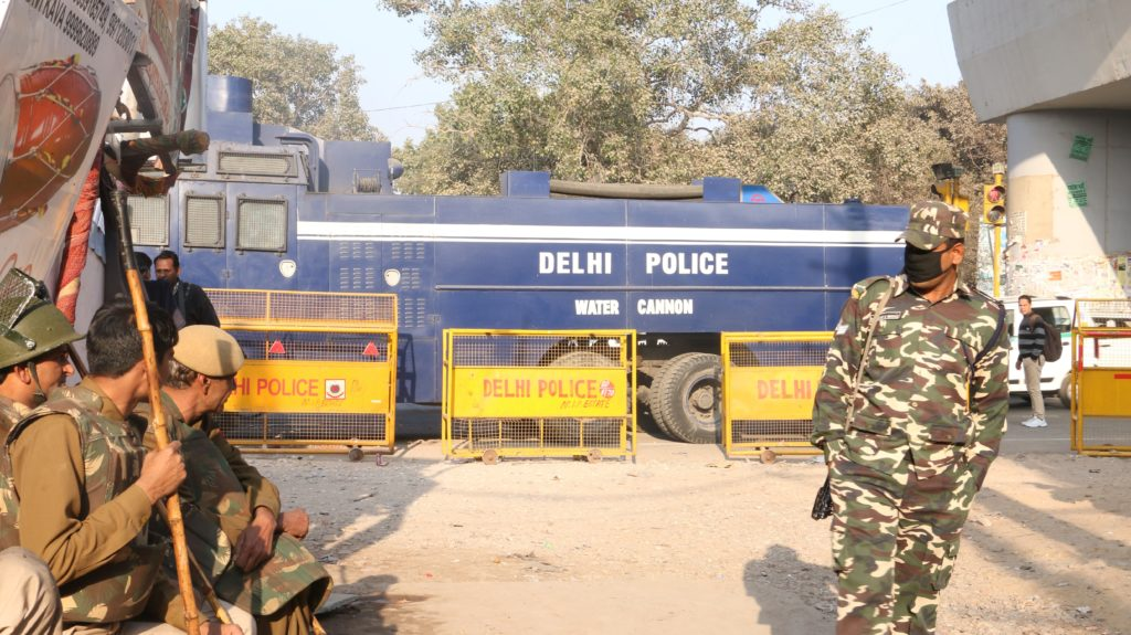 One of the entrances to Kathputli Colony, with a water-canon truck on standby at the barricaded periphery. Credit: Akshita Nagpal