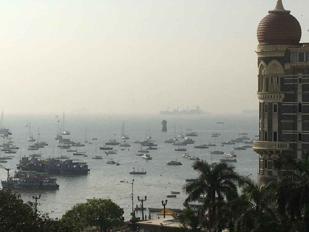 The Taj Mahal hotel, iconic property of the Tata group, silhouetted against the Arabian Sea. Credit: The Wire Staff