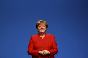 German Chancellor and leader of the conservative Christian Democratic Union party Angela Merkel reacts after she was re-elected as chairwoman at the CDU party convention in Essen, Germany, December 6, 2016. Credit: Reuters/Kai Pfaffenbach