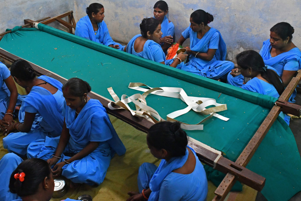 Rehabilitated manual scavengers breaks for lunch inside a room where they learn to work on embroidery inside a rehabilitation center called Nai Disha run by an NGO , in Alwar, Rajasthan, India on 23 September 2016. Credit: Anindito Banerjee