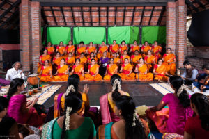 The event organised by Seetha Rajan. The women in orange are the singers. Credit: Ravi K.