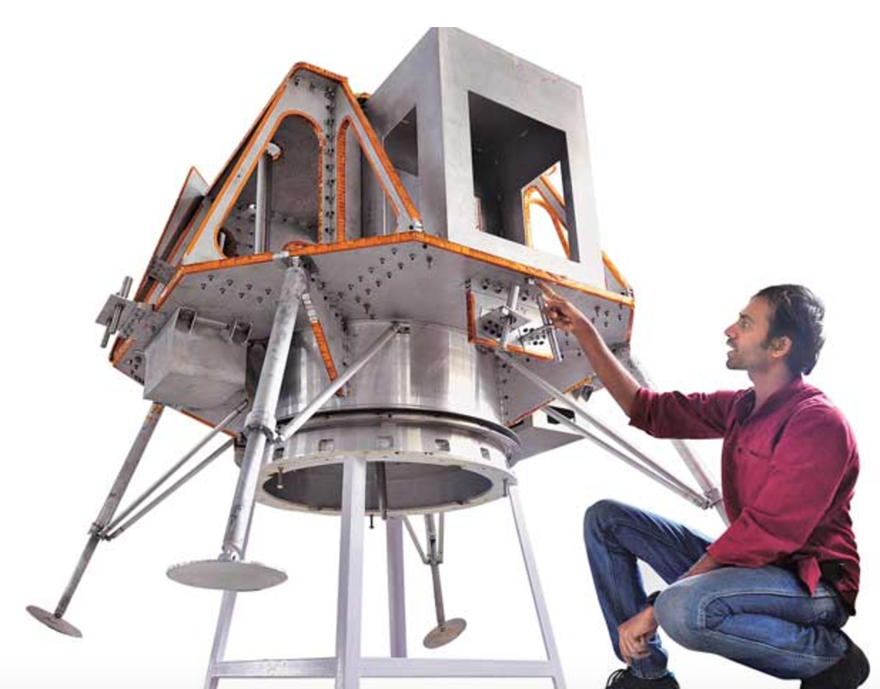 TeamIndus member Suranjan Mallick with a prototype of the lunar lander. Credit: TeamIndus