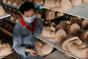 A worker checks a mask of Donald Trump at Jinhua Partytime Latex Art and Crafts Factory in Jinhua, Zhejiang Province, China, May 25, 2016. Credit: Reuters