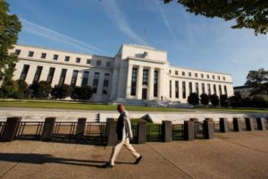 A man walks past the US Federal Reserve in Washington. Credit: Reuters/Kevin Lamarque