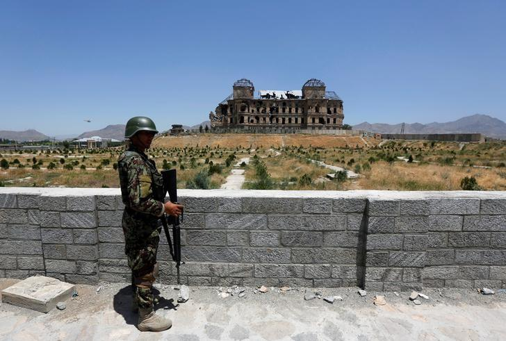 An Afghan National Army soldier stands guard after the inauguration of the reconstruction project to restore the ruins of historic Darul Aman palace, in Kabul, Afghanistan May 30, 2016. Credit: Reuters/Omar Sobhani