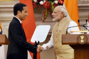 Prime Minister Narendra Modi shakes hands with Indonesian President Joko Widodo during a joint press statement at Hyderabad House in New Delhi on Monday. Credit: PTI/Subhav Shukla