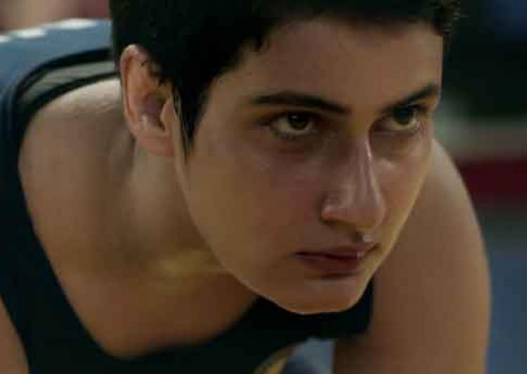 Geeta wrestling in <em>Dangal</em>.