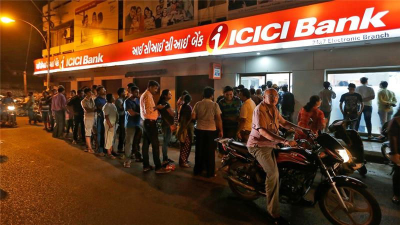 People stand in line outside ICICI bank. Credit: Reuters