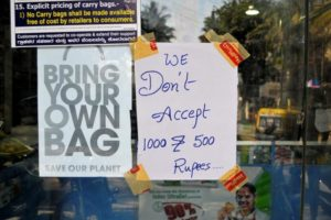 A notice is pasted on the window of a medicine shop stating the refusal of the acceptance of 500 and 1000 rupee banknotes in Bengaluru, India, November 10, 2016. REUTERS/Abhishek N. Chinnappa